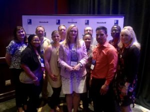 Goodwill staff accept the Center of Excellence Award at GII Spring Conference.